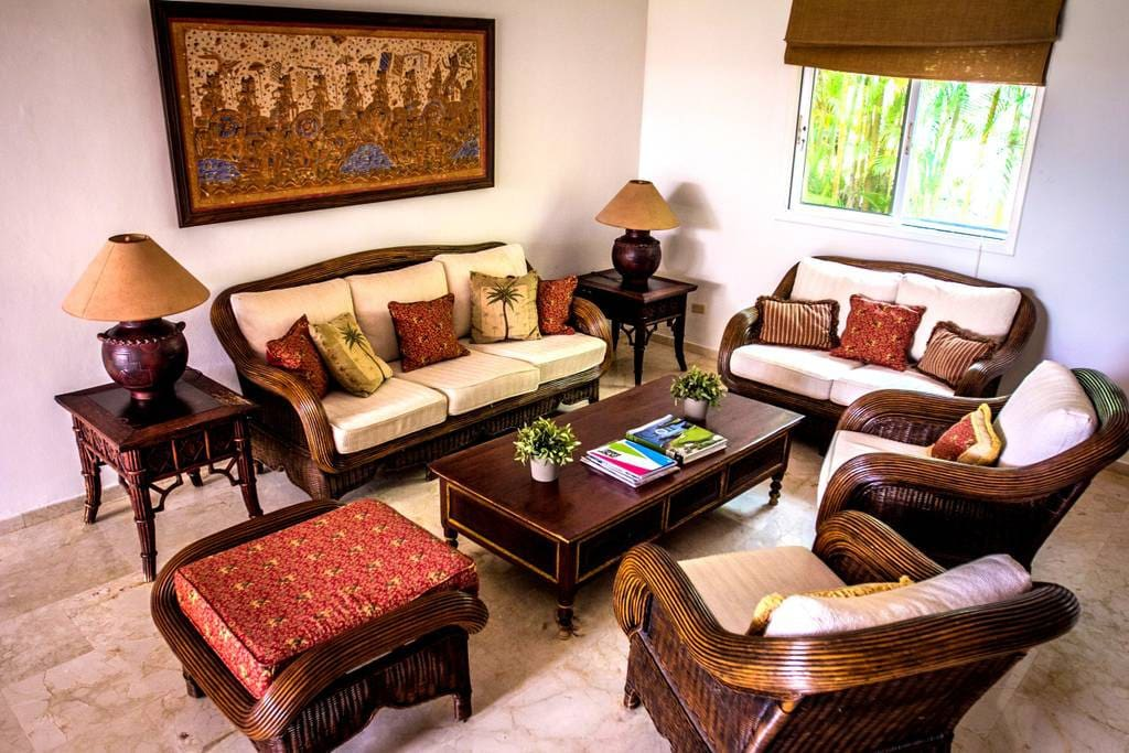 You will feel right at home in this cozy living room with premium wooden furniture.