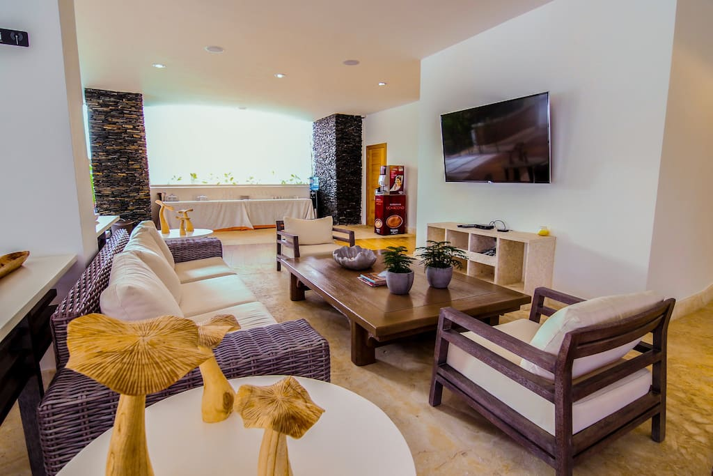 Nice interior details, cozy sofa and big TV. Enjoy your stay to the fullest!