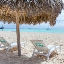 Enjoy the loungers and parasols for a relaxing day at the beach.