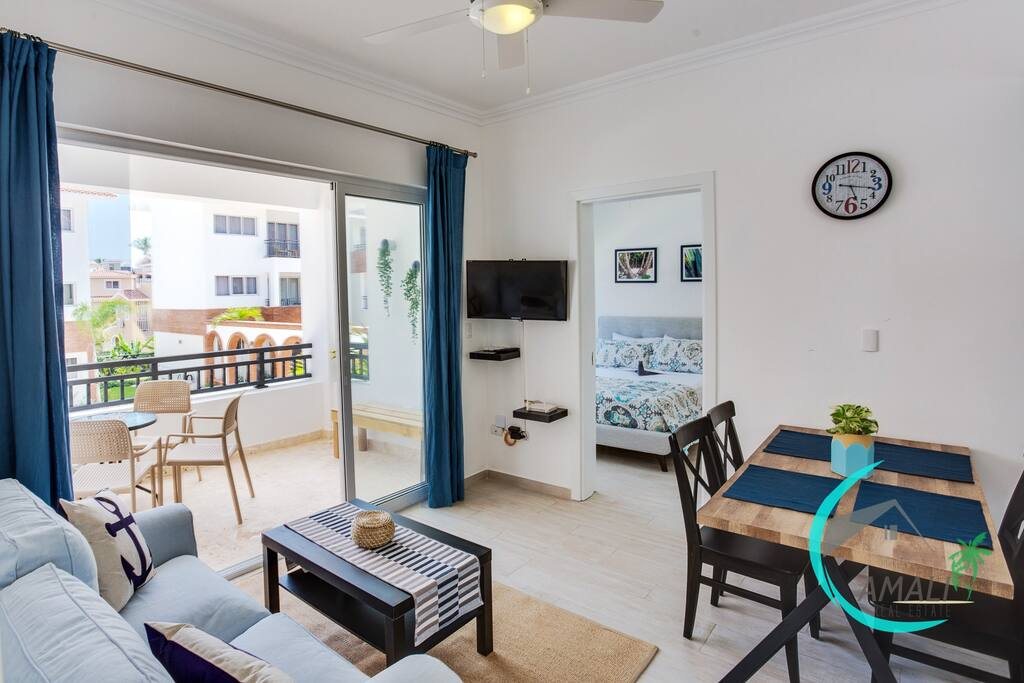 Lovely Living room with Dining area, full furnished kitchen, Sofa, TV and a spacious balcony overlooking the Residential Pool!