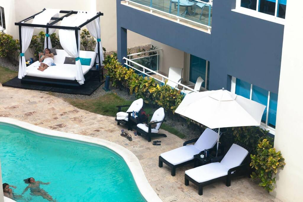 Comfortable chaise lounges for you to relax by the pool